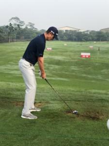 Professional golfer Justin Rose practising golf